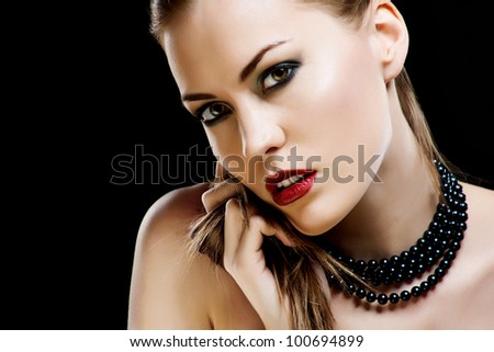 Beautiful woman with bright makeup. Close-up portrait. - stock photo
