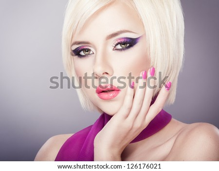 Beautiful woman with bright violet purple makeup, lips and manicure - stock photo