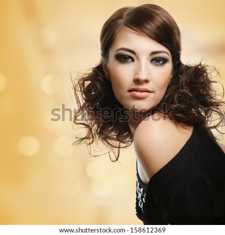 Beautiful woman with brown curly hairstyle - art background