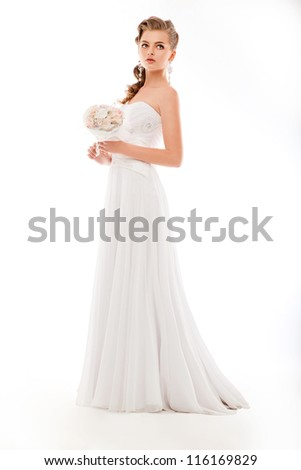 Beautiful woman with bunch of flowers, white wedding dress - stock photo