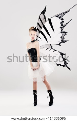 Beautiful Woman with Butterfly Wings - stock photo