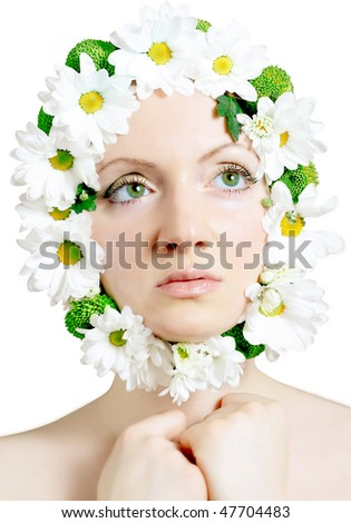 Beautiful woman with camomiles on isolated background - stock photo
