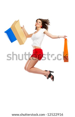 Beautiful woman with casual outfit and shopping bags in her hands over white background - stock photo