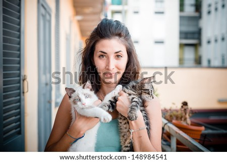 beautiful woman with cats at home - stock photo