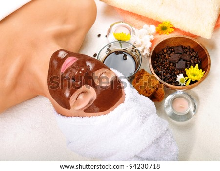 Beautiful woman with chocolate mask on her face - stock photo