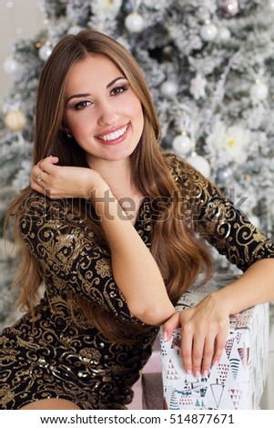 Beautiful woman with christmas gifts
