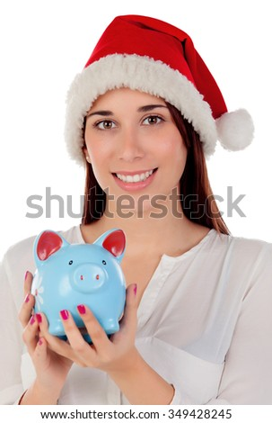 Beautiful woman with Christmas hat and piggy bank isolated on white background