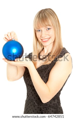 Beautiful woman with christmas toy smiling - stock photo