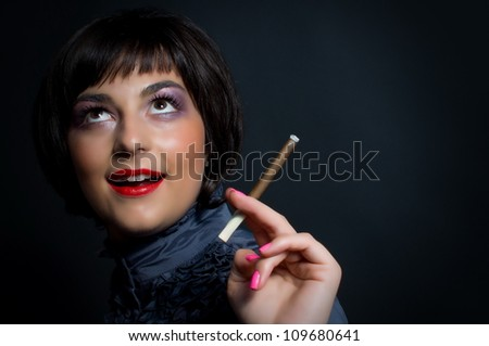 Beautiful woman with cigarette in vintage image - stock photo