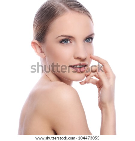 Beautiful woman with clean face over white background - stock photo