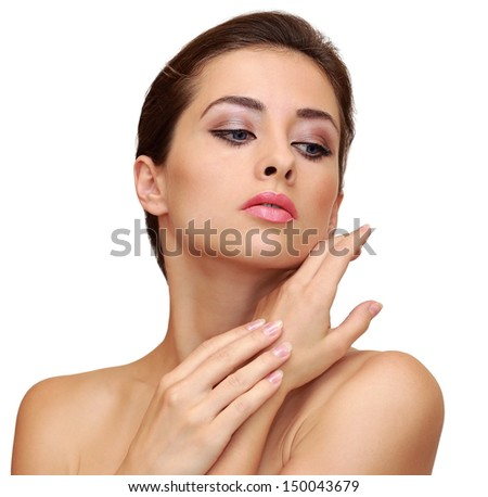 Beautiful woman with clean face skin posing isolated on white background - stock photo
