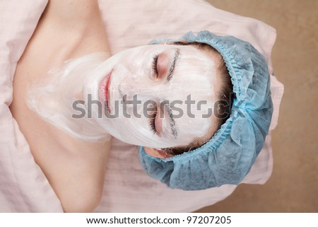 Beautiful woman with clear skin getting beauty treatment of her face at salon.  Clear Skin. - stock photo