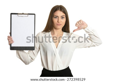 Beautiful woman with clipboard and thumb down sign on white background - stock photo