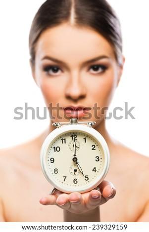 Beautiful woman with clock close up, serious  - stock photo