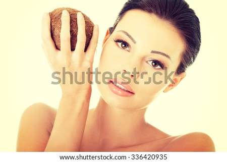 Beautiful woman with coconut in hands. - stock photo