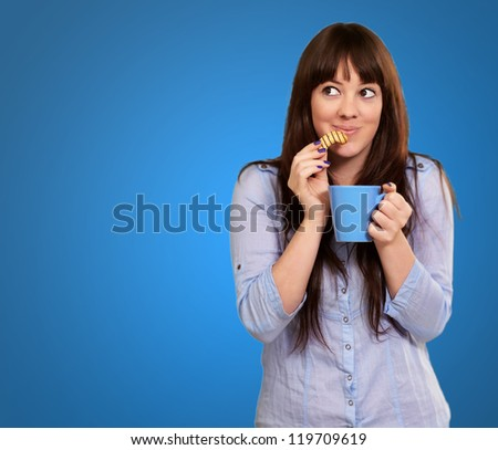 Beautiful Woman With Coffee And Cookies Isolated On Blue Background