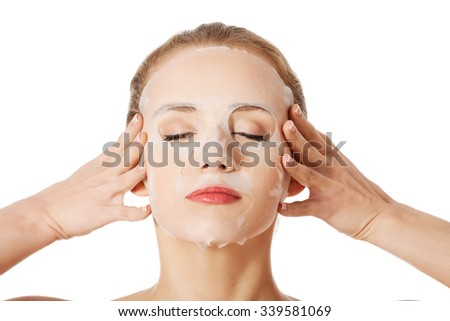 Beautiful woman with collagen mask on face. - stock photo