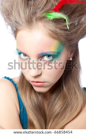 beautiful woman  with color makeup over white background