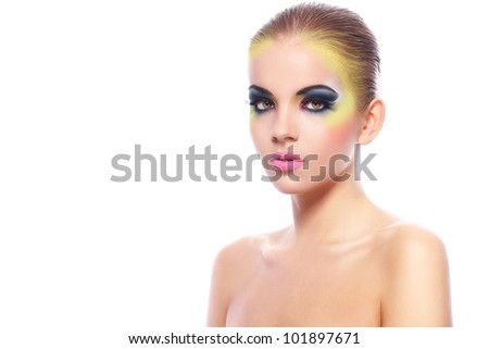 Beautiful woman with colorful make-up over white background - stock photo