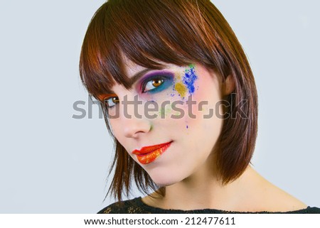 Beautiful Woman With Colorful Makeup - stock photo