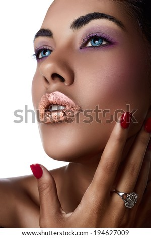 Beautiful Woman With Colorful Nails and Luxury Makeup with ring on tanned hands - stock photo