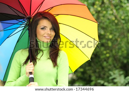 Beautiful woman with colorful umbrella - stock photo