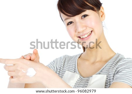 Beautiful woman with cream in her hand. Portrait of asian woman.