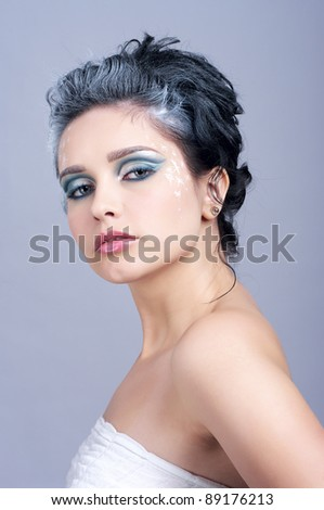 Beautiful woman with creative hairstyle and winter style make-up - stock photo