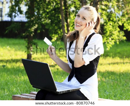 Beautiful Woman with Credit Card Using Her Laptop - stock photo
