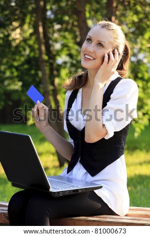 Beautiful Woman with Credit Card Using Her Laptop. - stock photo