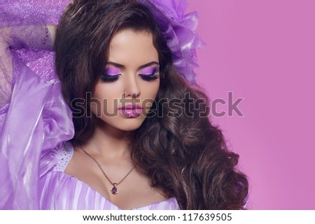 Beautiful woman with curly hair and bright make-up. Jewelry and Beauty. Fashion art photo - stock photo