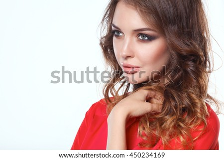 Beautiful woman with curly hair wearing a red jacket, isolated on white background - stock photo