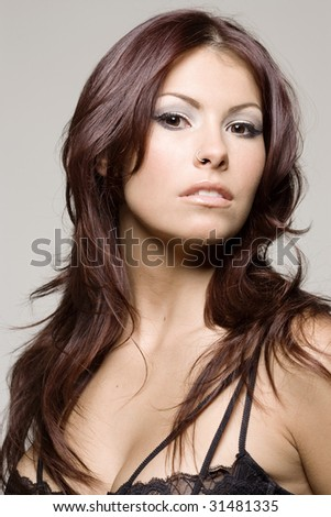 Beautiful Woman with dark hair beauty shot - stock photo