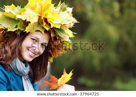 Beautiful woman with diadem made from yellow maple leaves