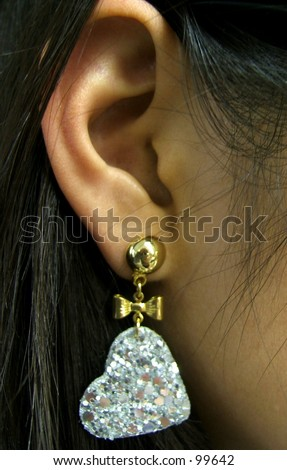 beautiful woman with diamond heart earing - stock photo