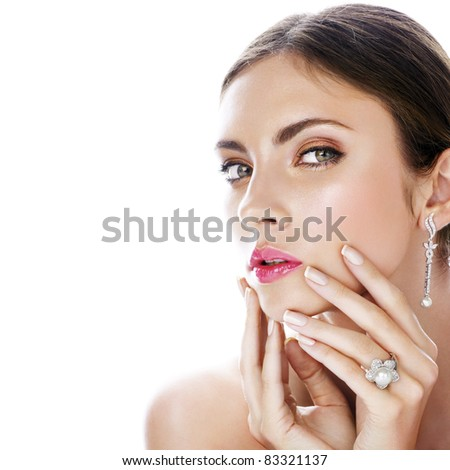 Beautiful woman with diamond jewelry. Space for text.