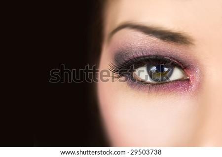 Beautiful woman with dramatic make-up - stock photo