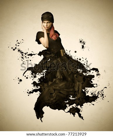 Beautiful woman with dress melting in black paint