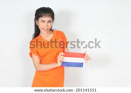 Beautiful woman with ducth flag in her hand - stock photo
