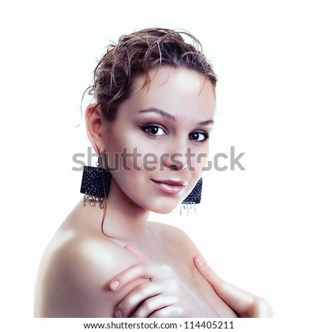 Beautiful woman with earrings and seductive smile - stock photo