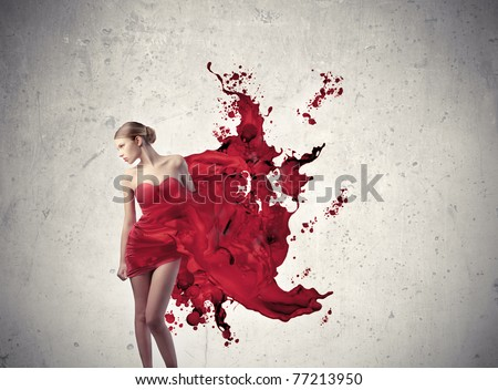 Beautiful woman with elegant dress melting in red paint
