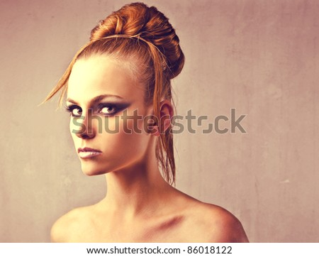 Beautiful woman with elegant hairstyle - stock photo