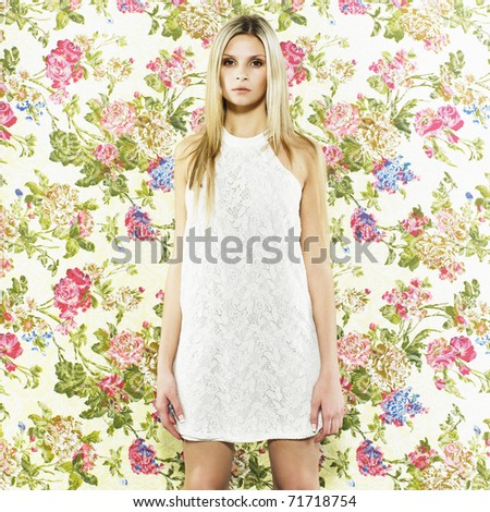 Beautiful woman with elegant white dress. Fashion photo - stock photo