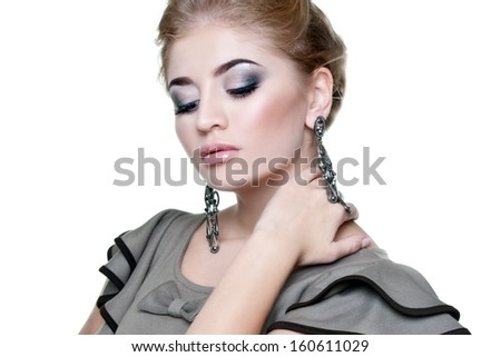 Beautiful woman with evening make-up and black earrings. Jewelry and Beauty. Fashion photo - stock photo