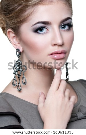 Beautiful woman with evening make-up and long earrings . Jewelry and Beauty. Fashion photo - stock photo