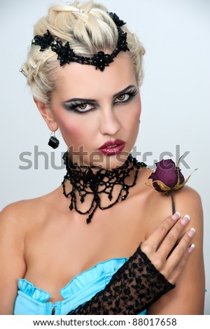 Beautiful woman with evening make-up and with a black necklace. Jewelry and Beauty. Fashion photo