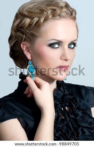 Beautiful woman with evening make-up. Evening hairdress - stock photo