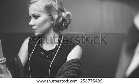 Beautiful woman with evening make-up. Jewelry and Beauty. Black and White photo - stock photo