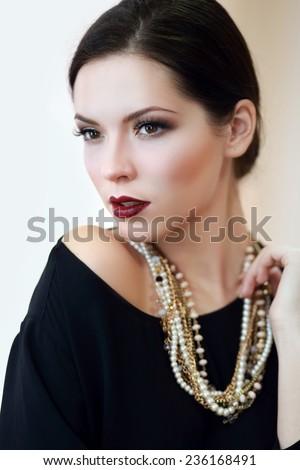 Beautiful woman with evening make-up. Jewelry and Beauty. Fashion photo  - stock photo