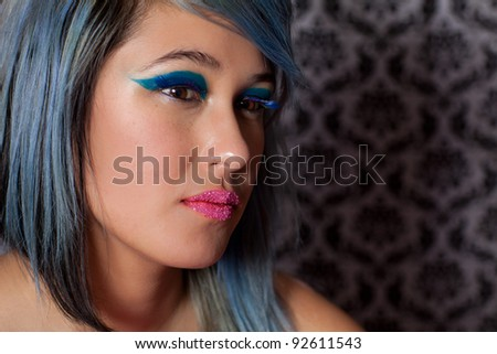 Beautiful Woman with exotic makeup and Pink Candy Lips